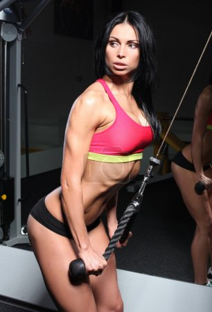 Photo for Girl shakes triceps - Royalty Free Image