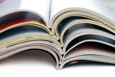 A stack of open magazines...