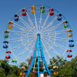 A colourful ferris wheel. Front view...