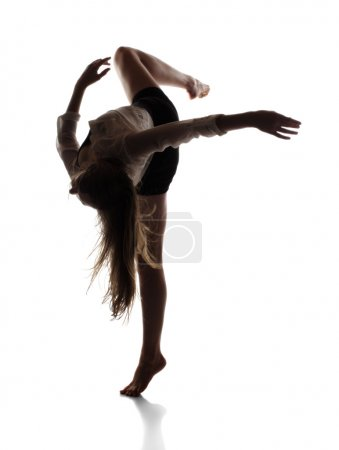 Photo for Beautiful slim young female modern jazz contemporary style ballet dancer in silhouette wearing a black leotard and white shirt isolated on a white studio background - Royalty Free Image