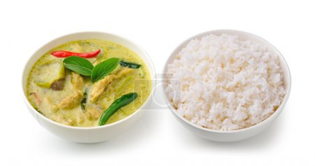 Thai food chicken green curry in the white bolw and rice on whit