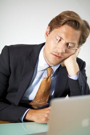 Sleepy businessman trying to stay awake