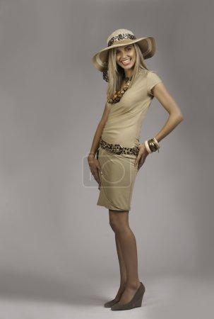 Beautiful blonde woman in safari chic outfit