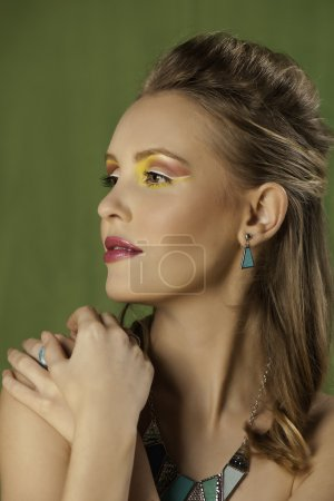 Beautiful blonde woman with colorful graphic makeup