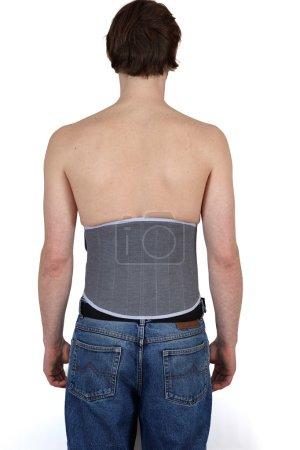 Man wearing lumber support belt.