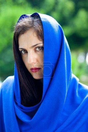 Beautiful young woman in head scarf