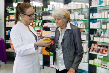 Pharmacist giving advices to senior female patient