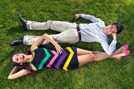 Vivacious teenagers lying head to toe.