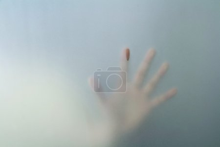 hand behind frosted glass