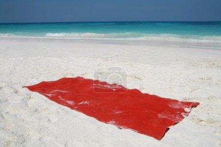 Red towel on beatiful beach, Tachai island, Similan island group