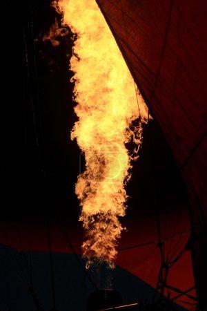 Hot air balloon burner flame glowing at night