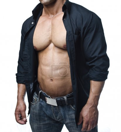 Male bodybuilder in jeans and open shirt revealing pecs and abs