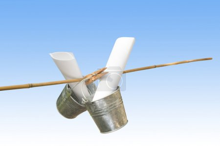 Two Galvanized Buckets Pegged On Bamboo Stick