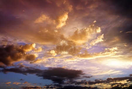 Beautiful cloudy sky. Cloudy abstract background. Sunset colors.