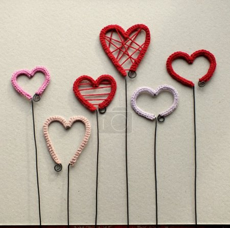 Crocheted decorations on the wire in the shape of heart