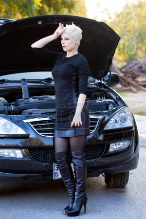 Blond Woman Repairs the Car