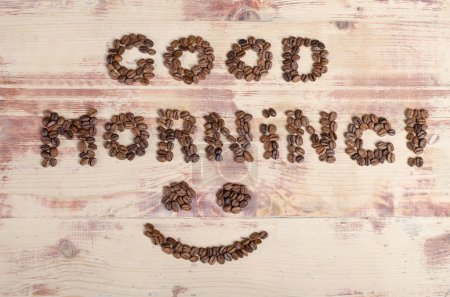 The inscription on wood good day with coffee beans
