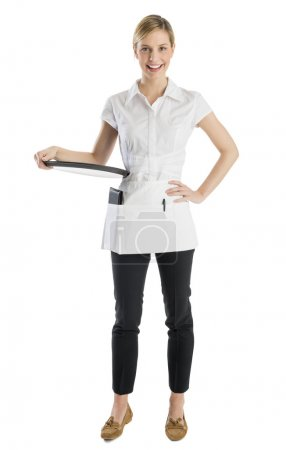 Photo for Full length portrait of happy waitress with serving tray standing against white background - Royalty Free Image