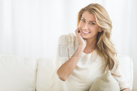 Happy Woman Sitting On Sofa