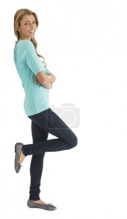 Side View Of Happy Woman With Arms Crossed