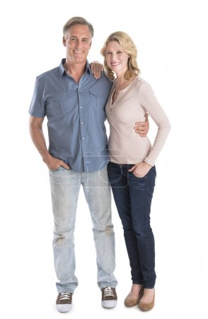 Mature Couple Standing With Hands In Pockets