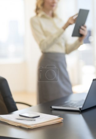 Documents And Laptop On Desk At Office