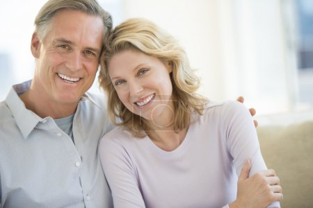 Photo for Portrait of mature couple smiling together at home - Royalty Free Image