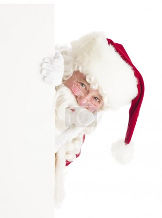 Photo for Portrait of Santa Claus peeking through blank sign against white background - Royalty Free Image