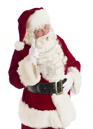 Photo for Portrait of Santa Claus pointing while standing against white background - Royalty Free Image