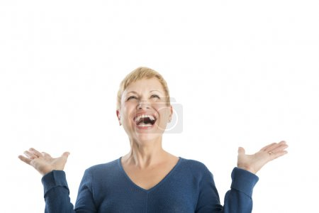 Cheerful Woman With Hands Raised Looking Up