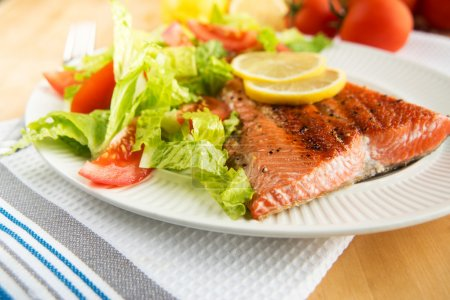 Grilled Salmon Fillet Served with Tomato and Romaine Salad