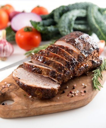 Cooked Pork Loin Roast with Vegetables and Spices