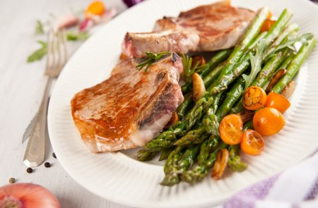 Grilled Pork Chops with Asparagus and Kumquat Oranges