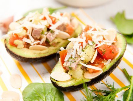 Avocado Halves Filled with Tomatoes, Beef and Toasted Almonds