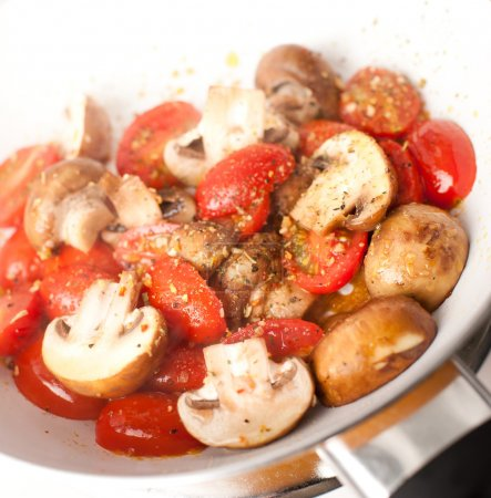 Tomatoes and Mushrooms Sauteed with Herbs and Spices in Enameled Pan