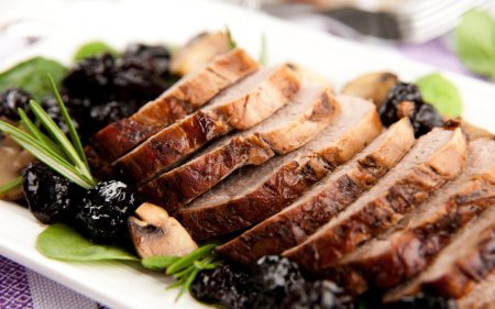 Photo for Pork Tenderloin with Cherry Sauce Served Over Mashed Cauliflower - Royalty Free Image