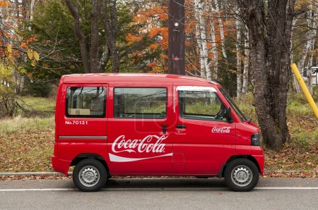 Tiny minibus delivers Coca-cola to remote locations in Japanese mountains.