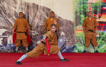 Shaolin monks do no-charge show to promote chinese martial arts.