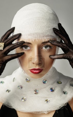 Beautiful woman with bandages on her head