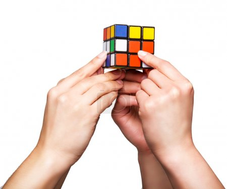 Hands holding cube