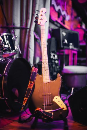 Photo for Electric bass guitar on the rack at concert - Royalty Free Image