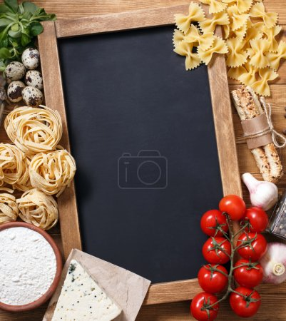 Photo for Italian food on vintage wood background, with chalkboard, with copyspace - Royalty Free Image