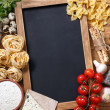Italian food on vintage wood background, with chal...