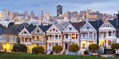 Panorama view of Alamo Square at sunset.