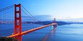 Panorama of Golden Gate Bridge at sunset