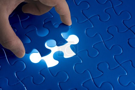 Photo for Missing jigsaw puzzle piece with light glow, business concept for completing the final puzzle piece - Royalty Free Image
