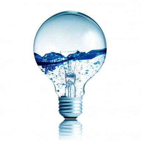Photo pour Concept énergétique. Ampoule avec eau à l'intérieur isolé sur blanc - image libre de droit