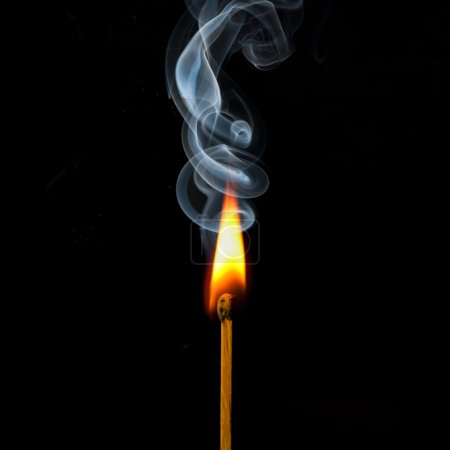 Spark of match with fire and smoke