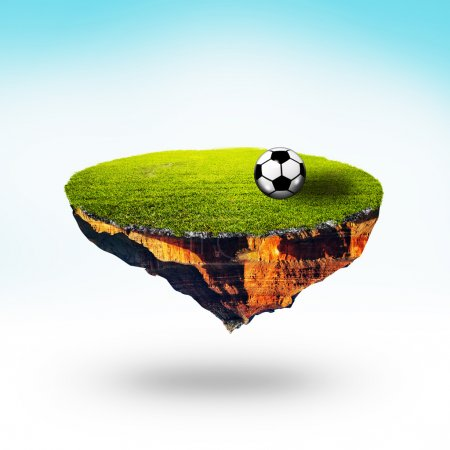 Soccer ball on field of floating planet