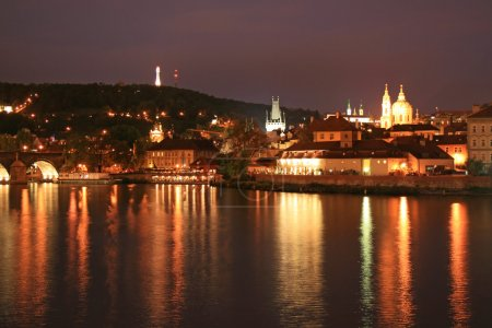 The night view of the beautiful Prague City along the River Vltava